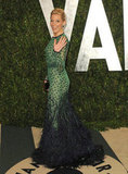 Elizabeth Banks in peacock-inspired Chadwick Bell gown gives a wave on the Vanity Fair carpet.