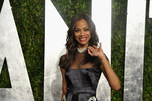 Zoe Saldana waves to the cameras.