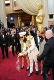 Sacha Baron Cohen couldn't help but make a scene, dumping ashes on the red carpet that he joked were those of Kim Jong-il.