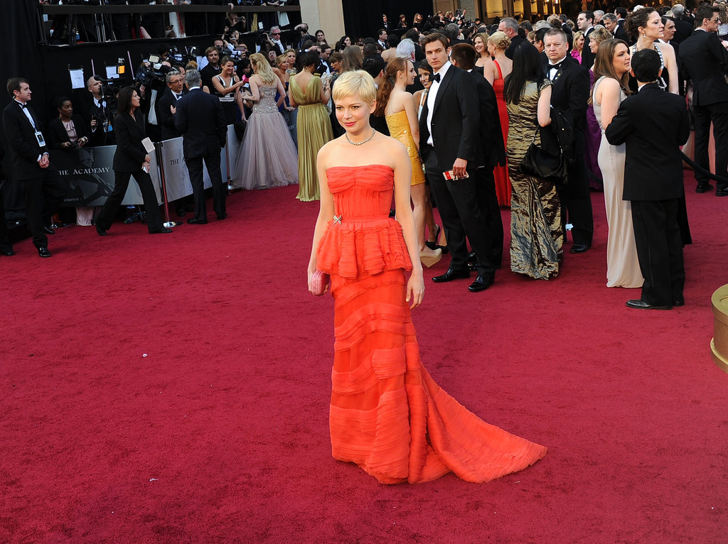 Michelle Williams's gown, which Louis Vuitton calls burnt orange, stood out against the red carpet.