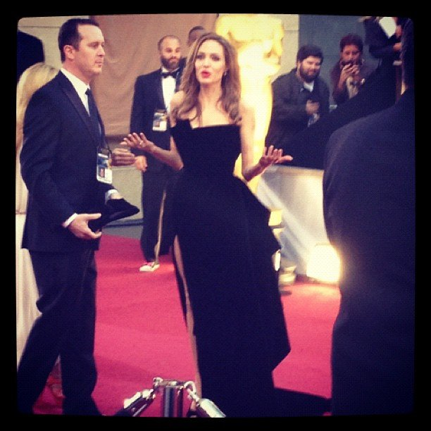 Angelina Jolie searched the red carpet for Brad Pitt — priceless!