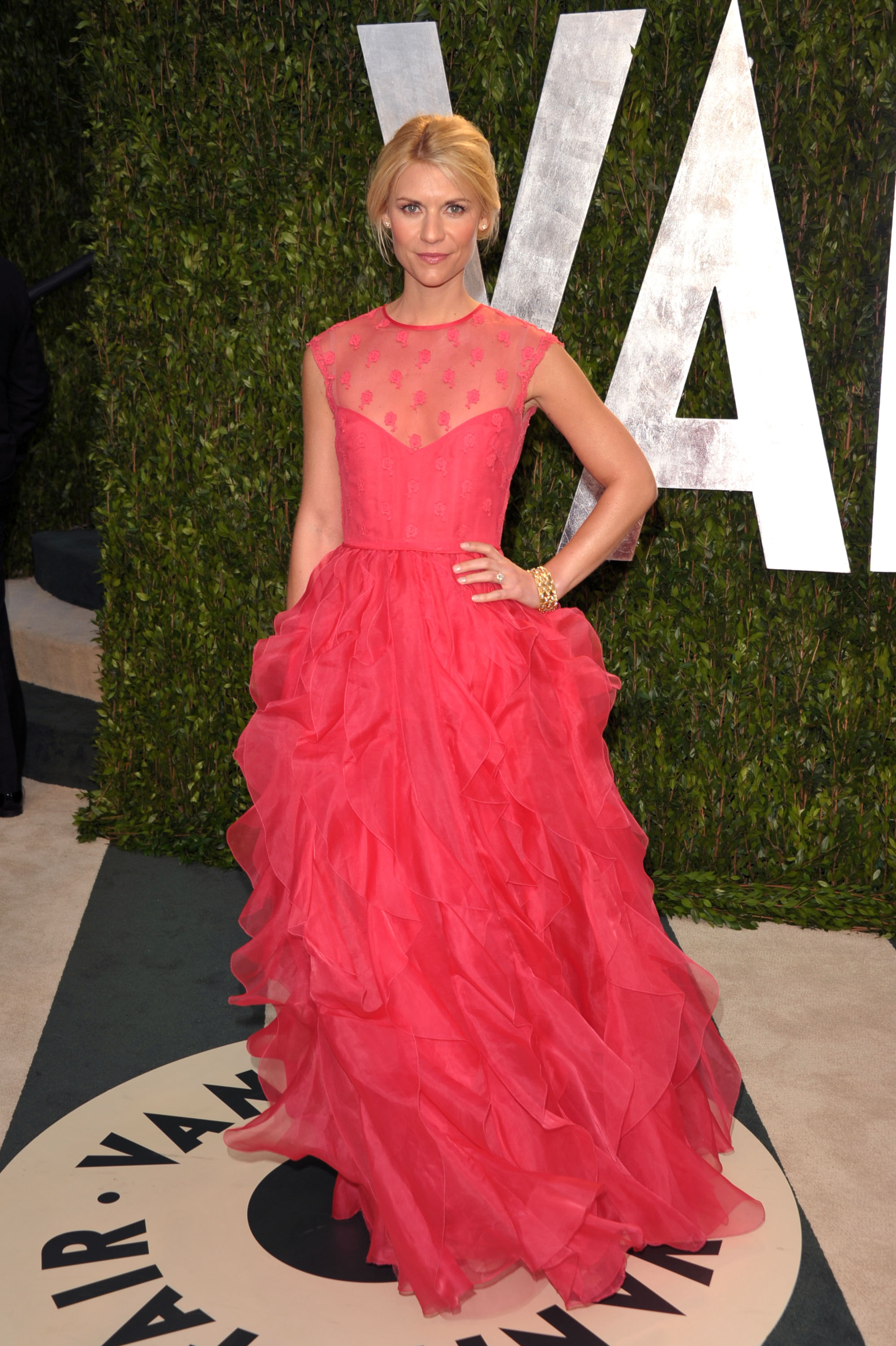 Claire Danes arrives at the Vanity Fair party wearing a Valentino gown.