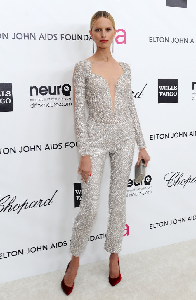 Karolina Kurkova wore a sparkly jumpsuit by Armani featuring a sexy sheer neckline.