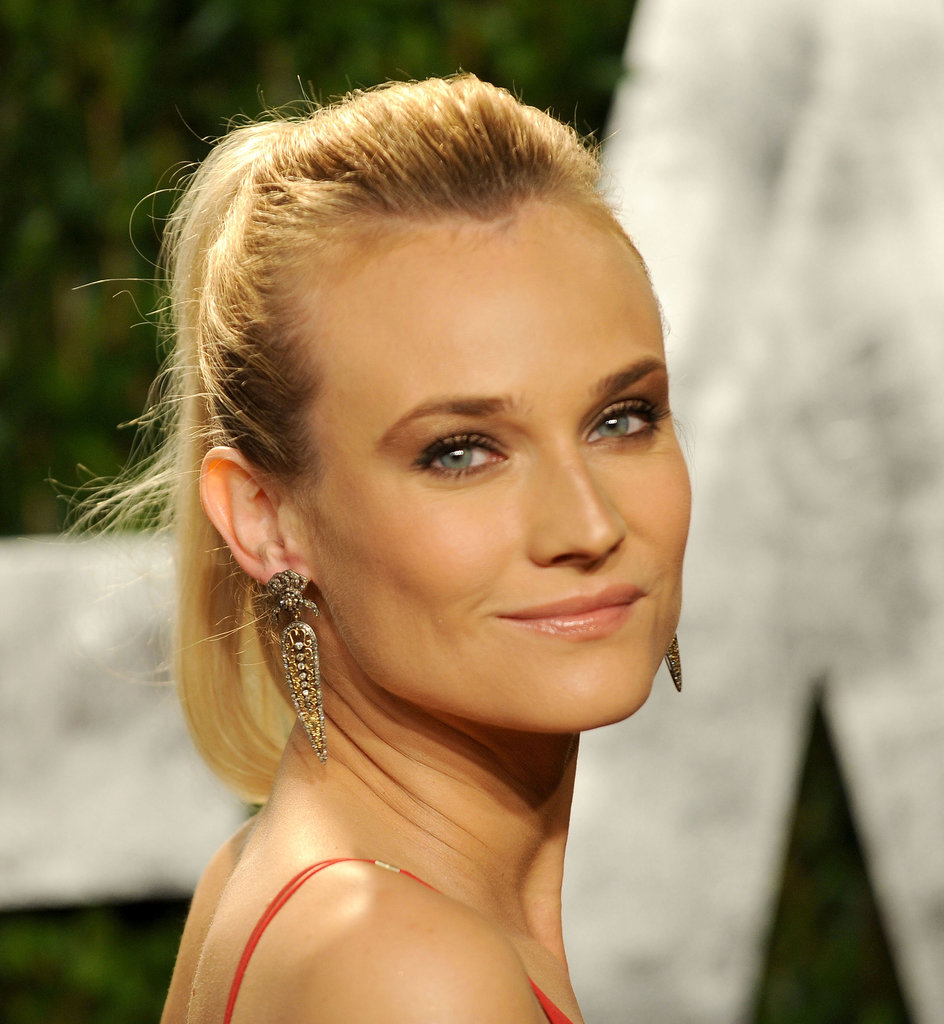 Get the feel of Diane Kruger's pretty earrings with a pair of antique-feeling rhinestone and gold drop jewels.  4801570