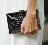 Rachel Zoe kept this bold croc-embossed clutch in hand.