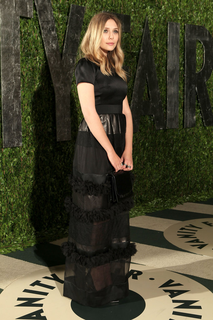 Elizabeth Olsen's Christian Dior gown featured a more conservative upper half, but a sheer skirt gave the gown an edgier finish.