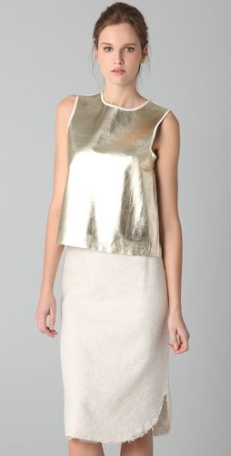 Rock this metallic crop top all season long, with tailored separates, flirty skirts, and more. Raoul Metallic Leather Tank ($325)