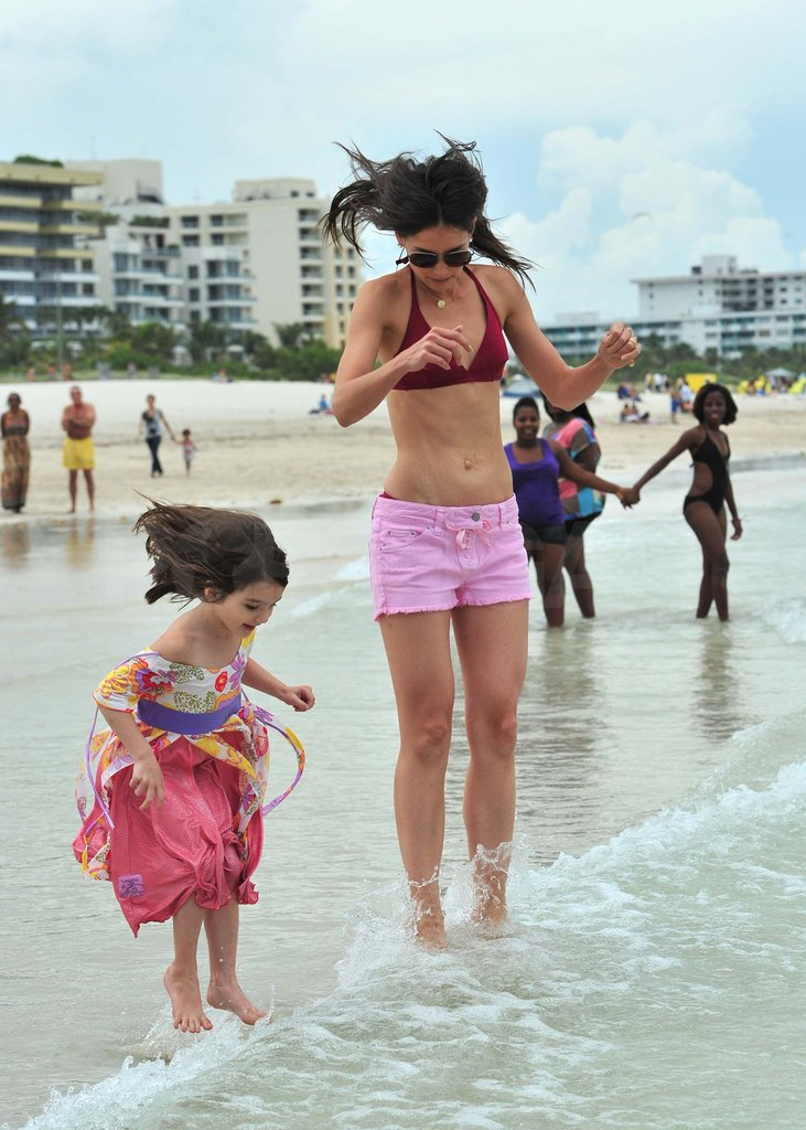 In 2011, Katie Holmes and Suri Cruise jumped up to avoid a wave in Miami.