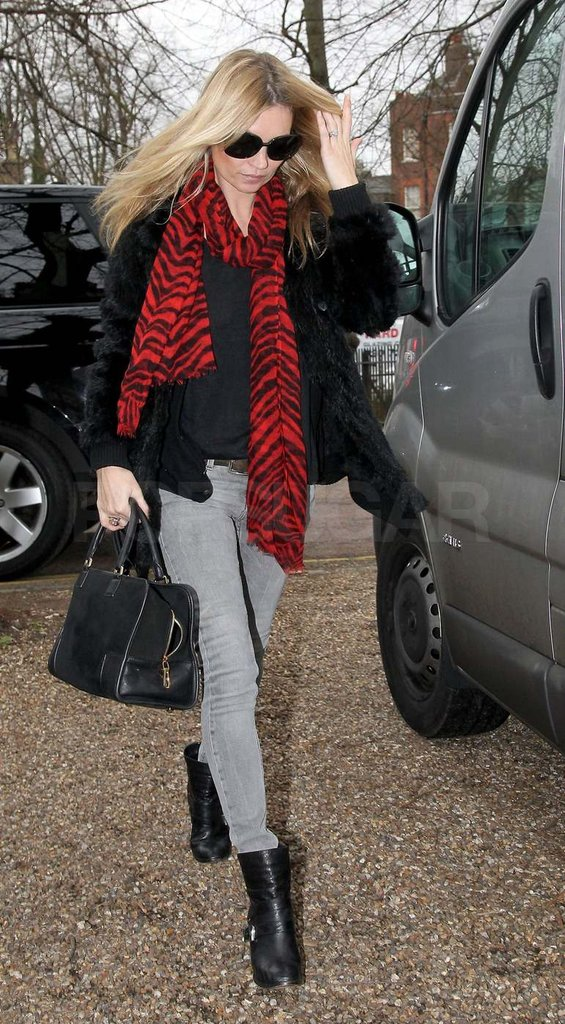 Kate Moss wearing a red scarf.