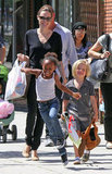 Zahara Jolie-Pitt hopped along the streets of LA with Angelina and Shiloh in 2011.