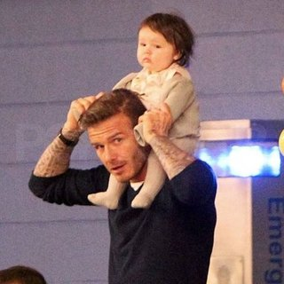 Harper Beckham Pictures on David Beckham's Shoulders