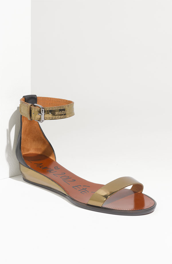 We love the simplified silhouette played up in a slick metallic finish. Keep your eye on a pair like this that could go anywhere come Spring.  Lanvin Ankle Strap Wedge Sandal ($745)