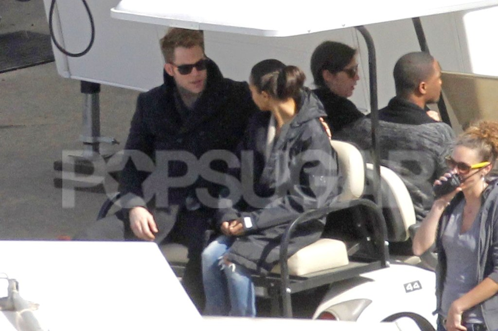 Zoe Saldana and Chris Pine started their day off with a golf cart ride.