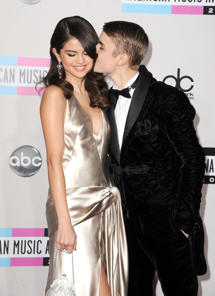 Justin Bieber showed PDA with Selena Gomez for the November 2011 American Music Awards cameras.