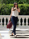 Miranda Kerr carried a large doctor's bag.
