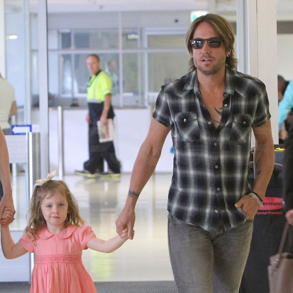Keith Urban held hands with daughter Sunday Rose.