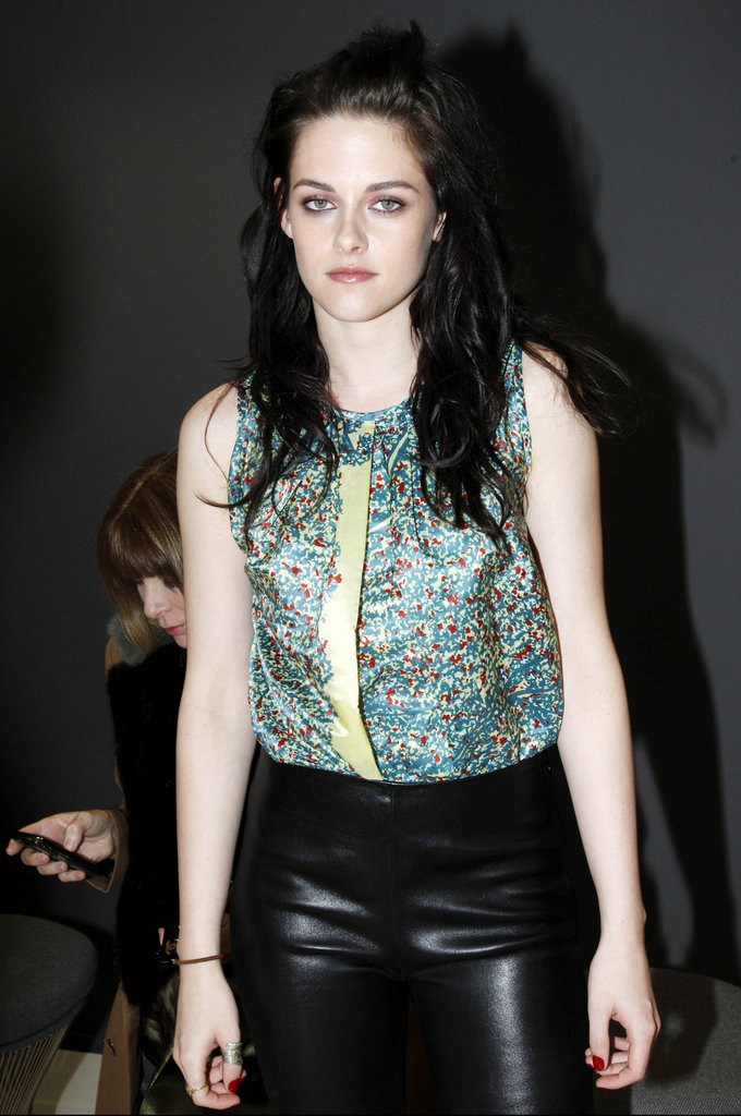 Kristen Stewart snapped a few photos before the runway show.