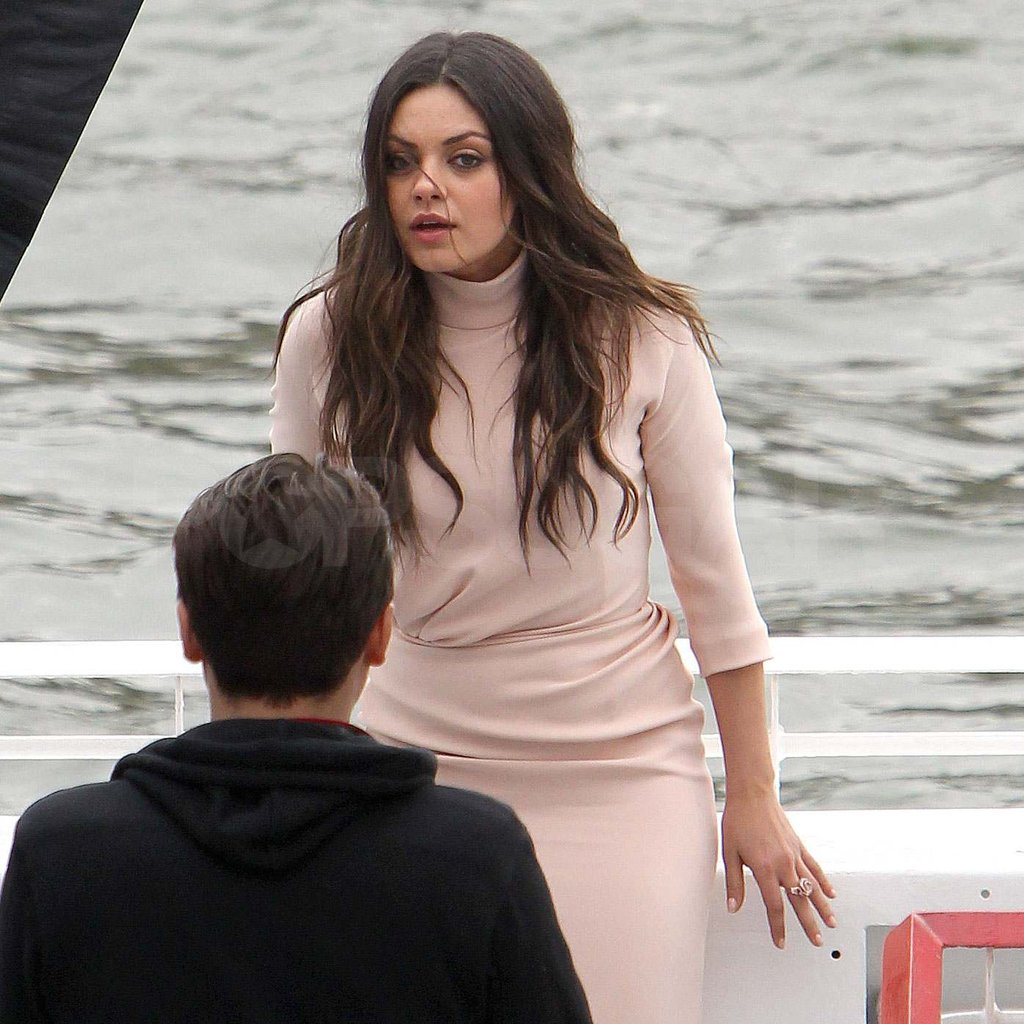 Mila Kunis in a pink dress.