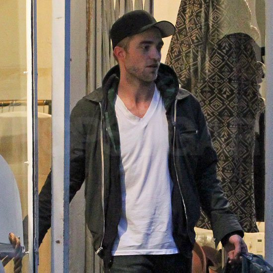 Robert Pattinson wore a plain white t-shirt, hoodie, and leather jacket for his shopping trip.
