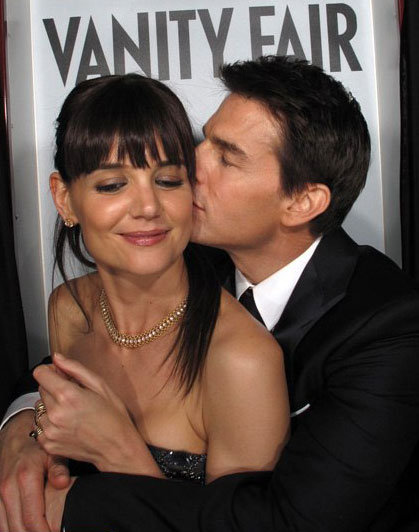 Katie Holmes and Tom Cruise kissing.