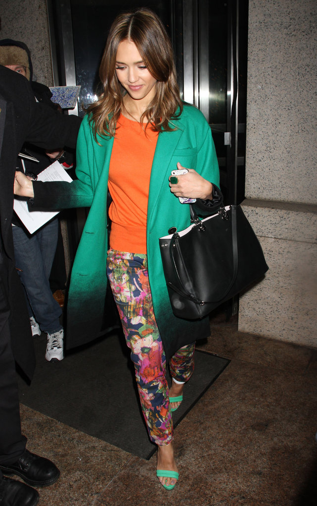 Jessica Alba's all dressed up Erdem florals and bold Doo.Ri coat are the stars of this show. Sure she may brighten the look with complementary tangerine and a pair of coordinating lime-green heels, but neither of the additions competes with the statement power of her brilliant green topper or botanical trousers.