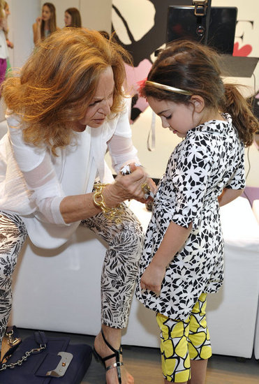 Diane von Furstenberg makes some minor adjustments to a wrap dress in her Gap Kids collection.
