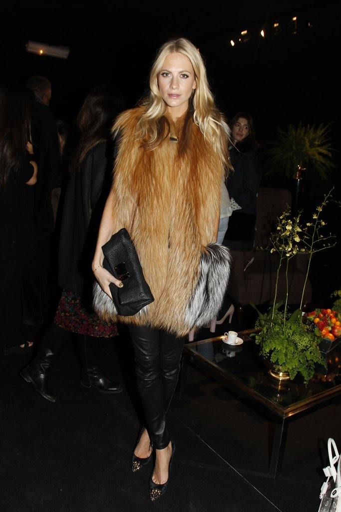 Poppy Delevigne showed off one of our favorite combos — a furry topper and leather pants — at Louis Vuitton.