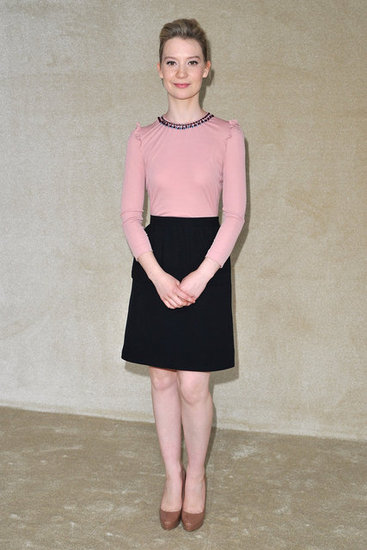 Mia Wasikowska looked sweet in a pretty pink and black frock at Miu Miu.