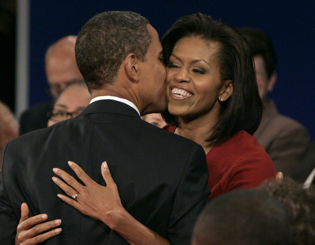 Michelle gets a kiss on the cheek from Barack following a town hall debate.
