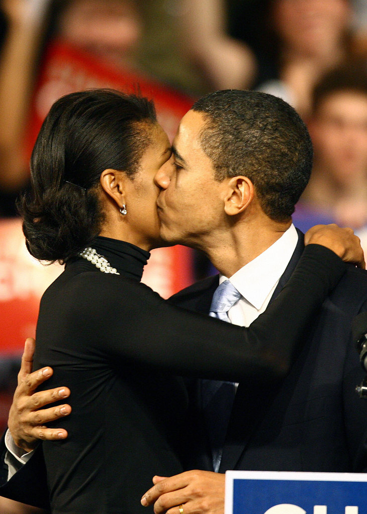 Barack Obama kisses his wife, Michelle, after losing to Hillary Clinton in New Hampshire.
