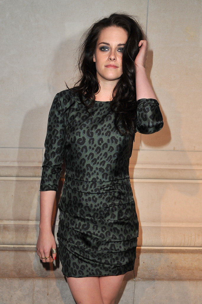 Kristen Stewart in a leopard dress at the opening of the Louis Vuitton Marc Jacobs Exhibit in Paris.