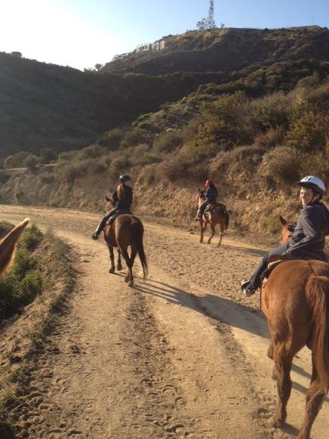 Victoria Beckham and son Brooklyn riding horses in LA.
