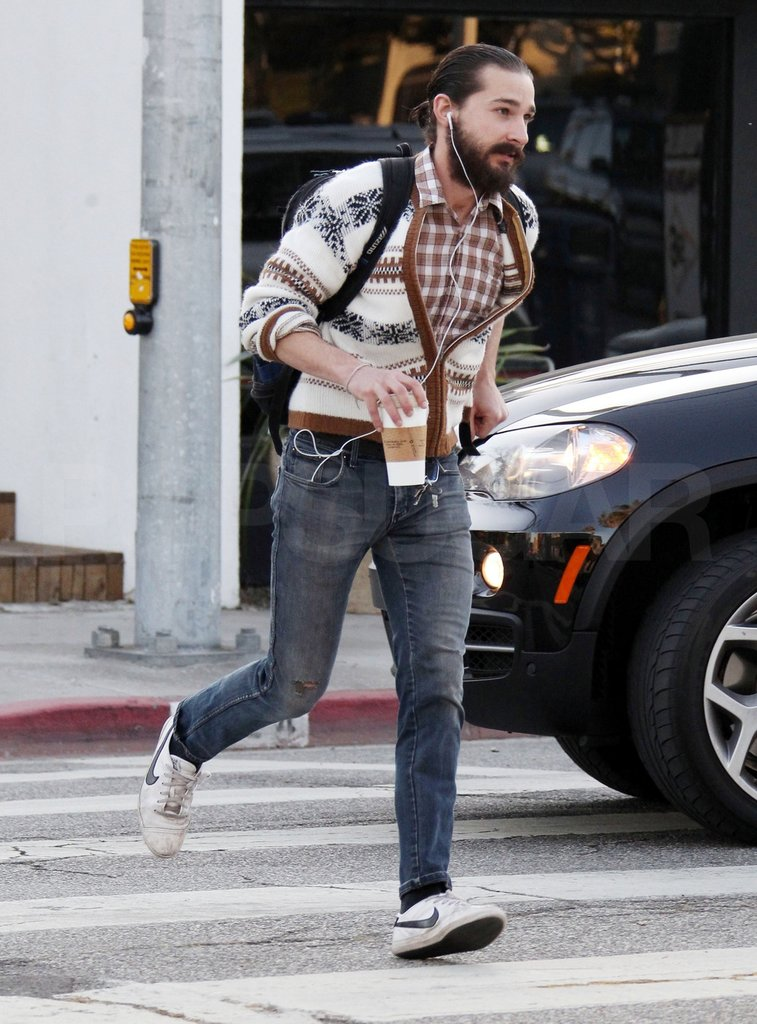 Shia LaBeouf showed a beard and ponytail.