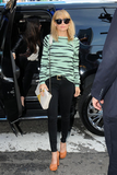 For yet another NYC appearance, Nicole wore a Proenza Schouler sweater with black skinny jeans, tan pumps, and retro round glasses.                       Skinny Denim by 7 For All MankindPlatforms by C Label