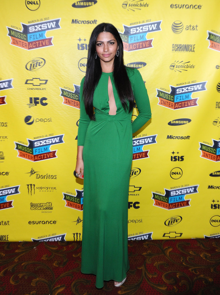 Camila Alves donned a sleek green keyhole Issa dress with no-frills nude pumps.