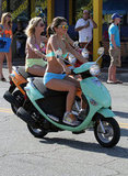 Selena Gomez led the pack in her turquoise scooter.