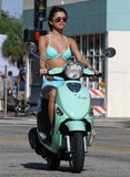 Selena Gomez's two-piece bikini matched her similarly colored ride.