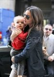 Miranda Kerr carried baby Flynn Bloom.