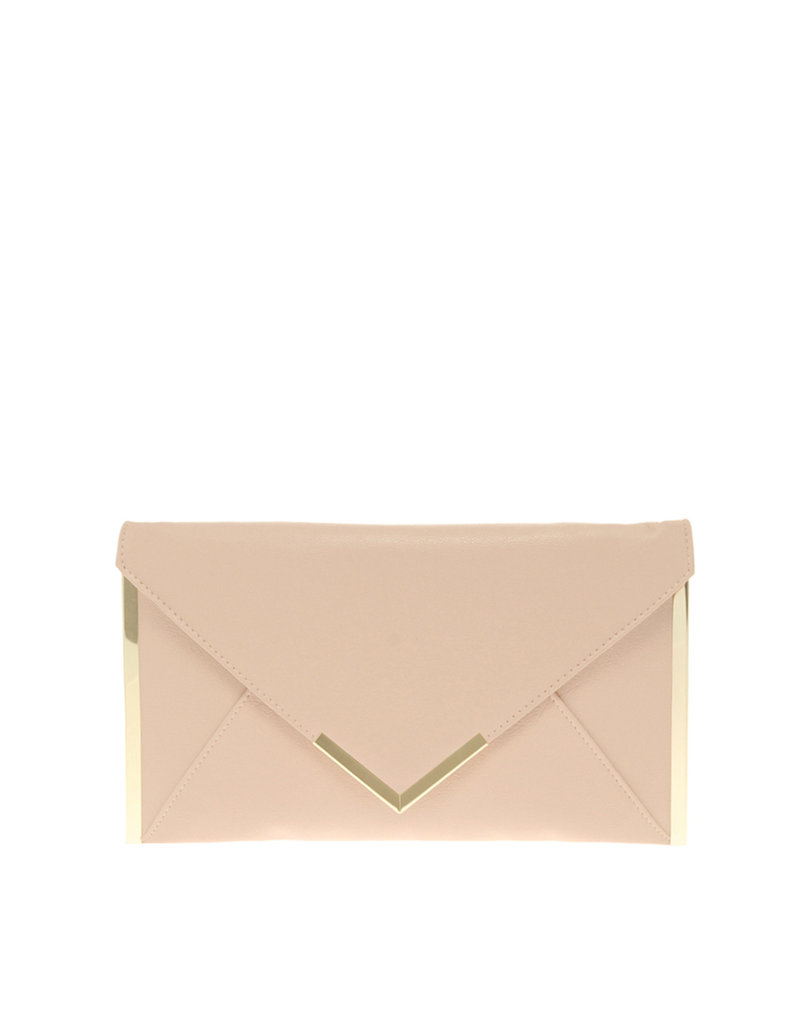 Pare down for Spring and try carrying a sleek clutch instead of an oversize tote.  Asos Metal Bar Detail Clutch ($32)