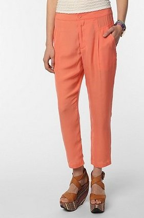 Add an extra pop to these orange trousers by pairing it with a green top and wedges for a striking colorblocked look.  Silence & Noise Soft Ankle Trouser ($59)