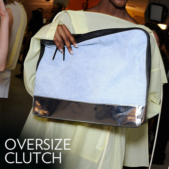 Why we love it: The oversize clutch offers the sophistication of a classic clutch, but delivers unrivaled cool to your look. The effect is both polished and effortless all at the same time. How to wear it: These clutches aren't evening-exclusive. Turn up the statement power of any everyday look with one of these in tow; tucked under your arm or right in hand they lend a kind of modern confidence to your look. Photo: Phillip Lim Spring 2012
