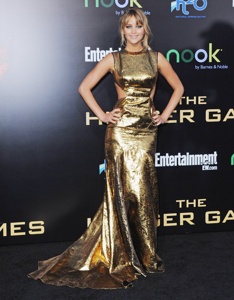 At the LA premiere of The Hunger Games, Jennifer Lawrence made an appearance in knockout gold lamé cut-out gown from Prabal Gurung's A/W 2012 collection.