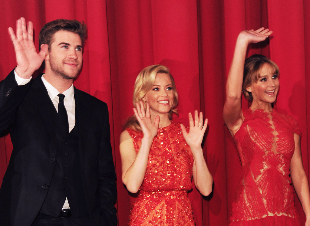 Liam Hemsworth, Elizabeth Banks, and Jennifer Lawrence got animated during an event in Berlin.