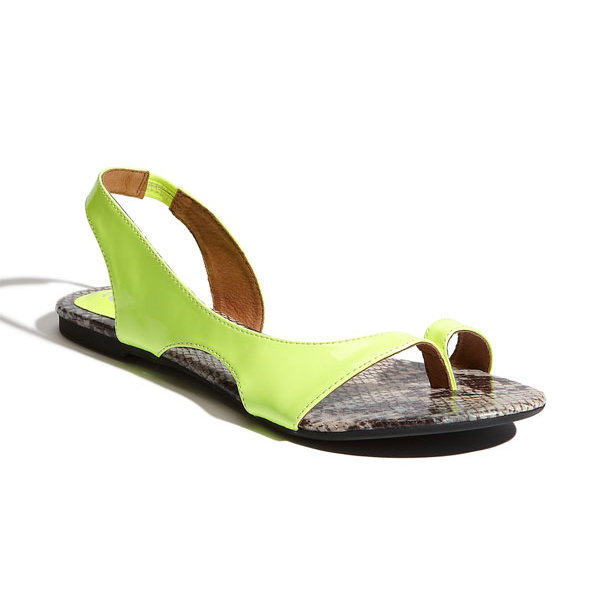 Loud and fabulous, turn heads with these neon yellow sandals with a split-toe and snakeskin-embossed footbed.  Jeffrey Campbell 'Eddy' Sandal in Neon Yellow Patent ($85)