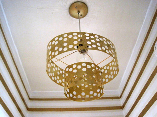 Use brass sheets to create this brass pendant lamp with punched-out polka dot patterns.