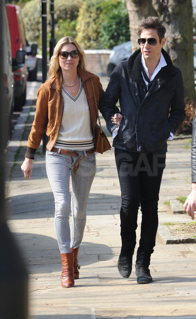 Kate Moss and Jamie Hince held hands.