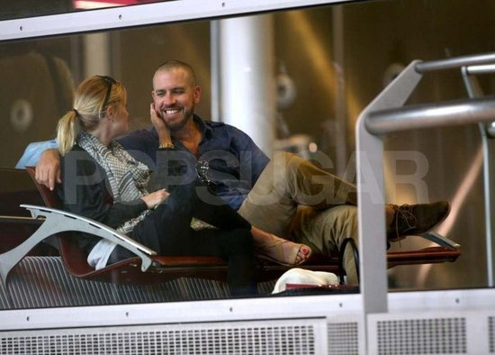Reese Witherspoon and Jim Toth looked sweet while hanging out at a Paris airport in 2011.
