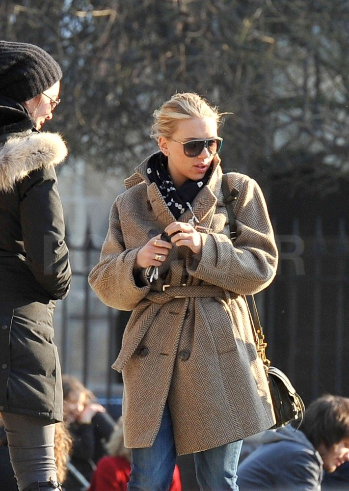 Scarlett Johansson kept warm in a jacket and scarf while she walked through Paris.