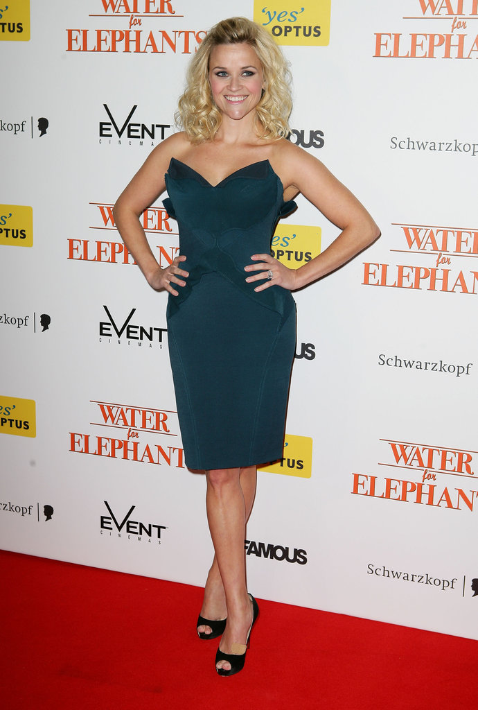 "Reese continued her Water For Elephants press tour in this stunning strapless Zac Posen dress that screamed ""va va voom."""
