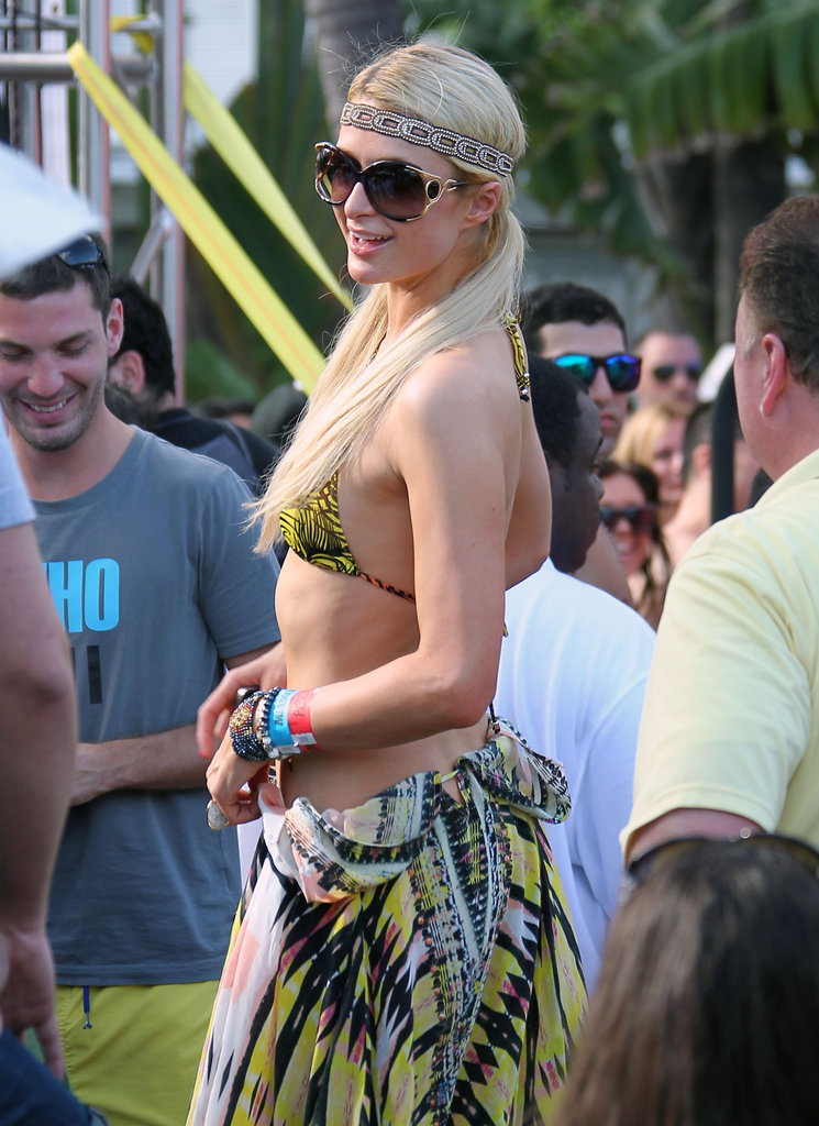 Paris Hilton rocked a headband and sunglasses by the pool.